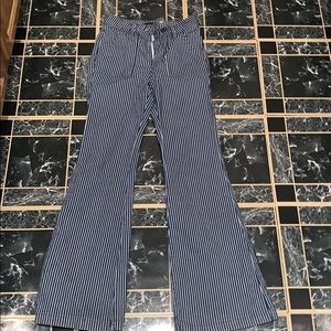 Flared pants with blue and white strips